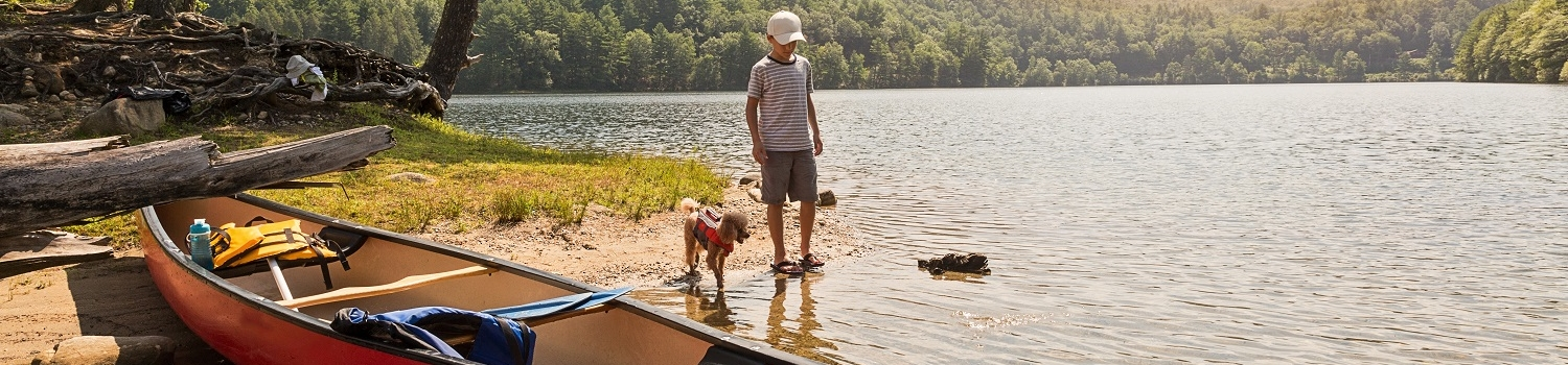 SHUTTERSTOCK – boy with dog & boat 1500